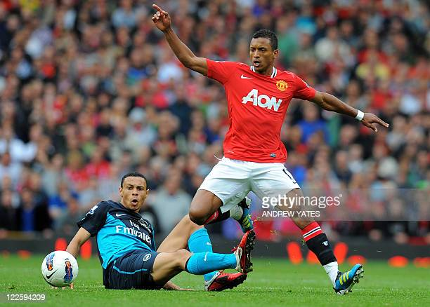 Manchester United's Portuguese midfielder Nani vies with Arsenal's French midfielder Francis Coquelin during the English Premier League football...