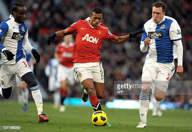Manchester United's Portuguese midfielder Nani vies with Blackburn Rovers' French defender Pascal Chimbonda and English defender Phil Jones during...