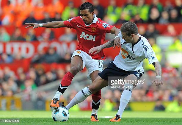 Manchester United's Portuguese midfielder Nani vies with Bolton Wanderers' Icelandic defender Gretar Rafn Steinsson during the English Premier League...