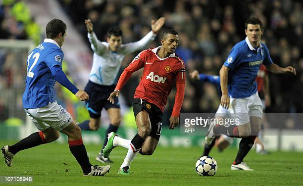 Manchester United's Portuguese midfielder Nani vies with Rangers' Scottish defender Ricky Foster and Rangers' Scottish midfielder Lee McCulloch...