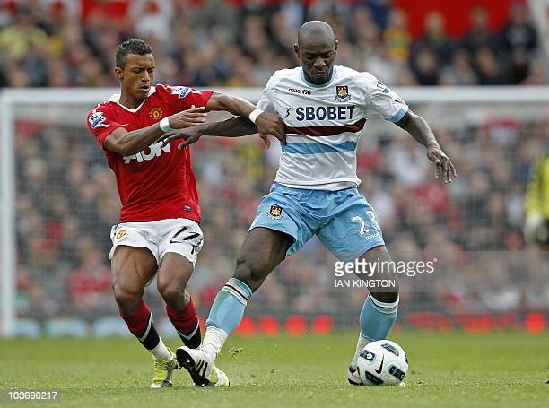 Manchester United's Portuguese midfielder Nani vies with West Ham United's Congolese defender Herita Ilunga during the English Premier League...