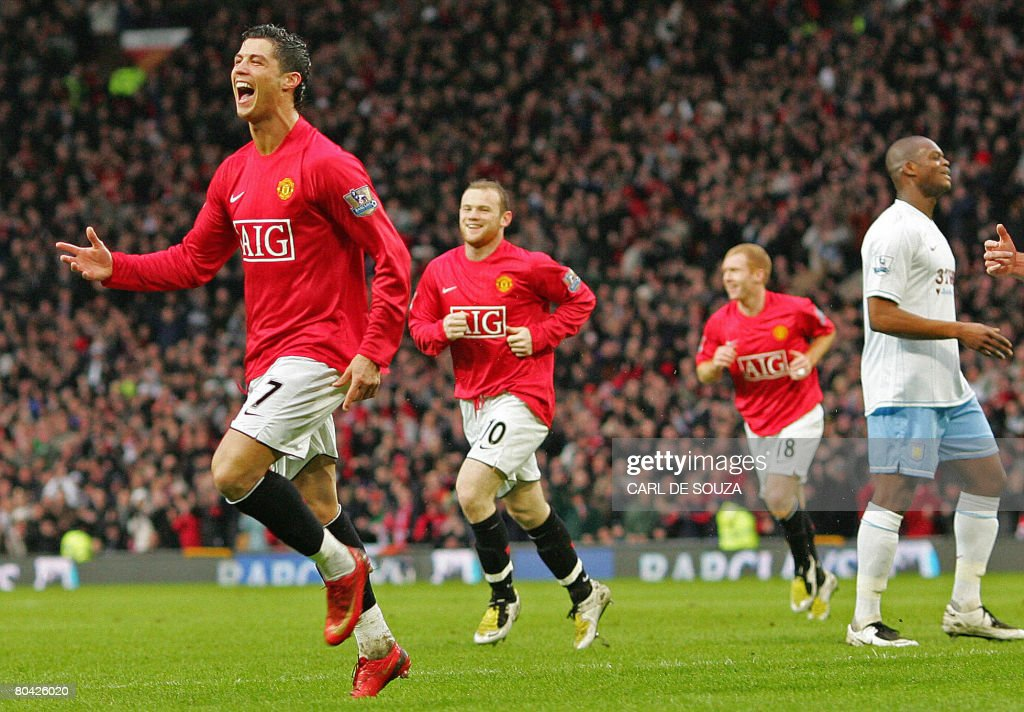 Manchester United's Portuguese player Cristiano Ronaldo (L) celebrates after scoring their first goal of the match during their Premiership match against Aston Villa at home to Manchester United at Old Trafford football stadium on March, 29 2008. AFP PHOTO/CARL DE SOUZA Mobile and website use of domestic English football pictures are subject to obtaining a Photographic End User Licence from Football DataCo Ltd Tel : +44 (0) 207 864 9121 or e-mail accreditations@football-dataco.com - applies to Premier and Football League