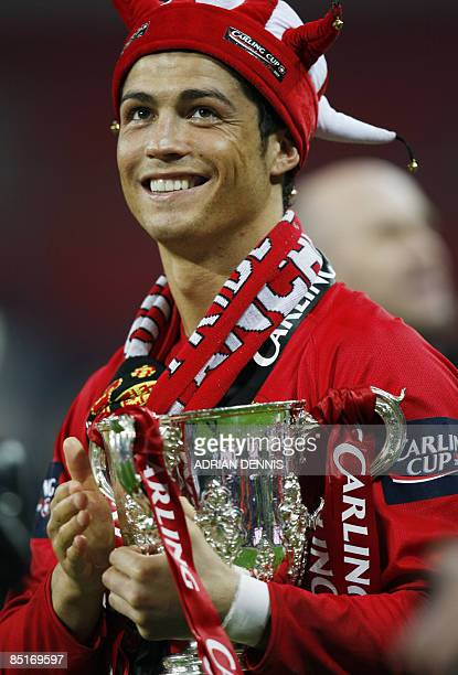 Manchester United's Portuguese player Cristiano Ronaldo holds the trophy after his team beat Tottenham Hotspur during the 2009 Carling Cup final at...