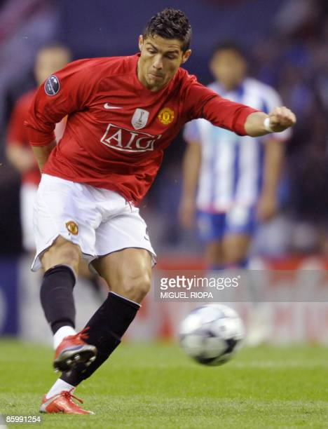 Manchester United´s Portuguese player Cristiano Ronaldo shoots to score against FC Porto during their UEFA Champions League quarter final second leg...