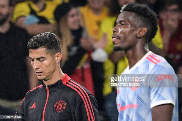 Manchester United's Portuguese striker Cristiano Ronaldo and Manchester United's French midfielder Paul Pogba react at the end of the during the UEFA...