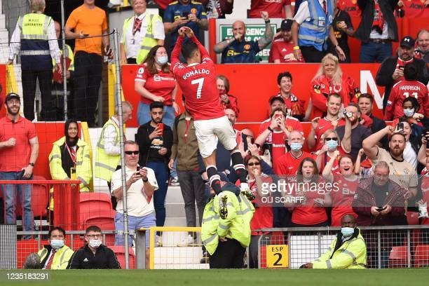 Manchester United's Portuguese striker Cristiano Ronaldo celebrates after scoring the opening goal of the English Premier League football match...