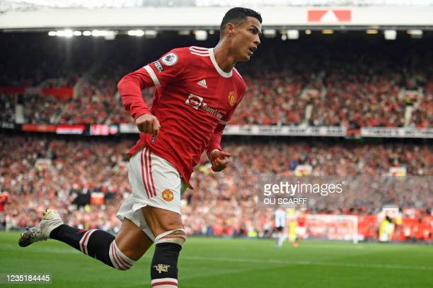 Manchester United's Portuguese striker Cristiano Ronaldo celebrates after scoring their second goal during the English Premier League football match...