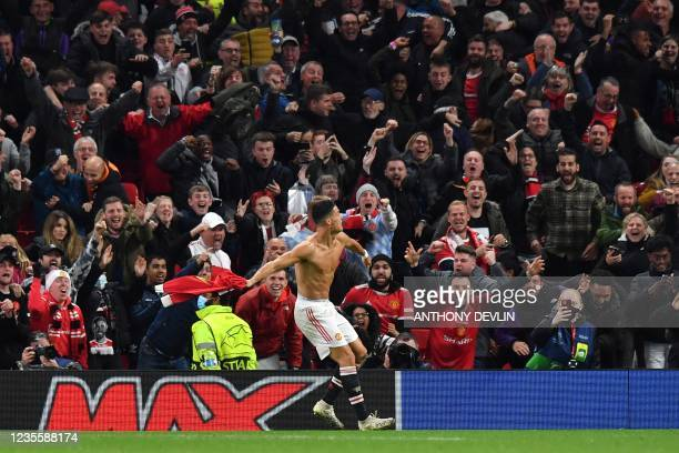 Manchester United's Portuguese striker Cristiano Ronaldo celebrates scoring his team's second goal during the UEFA Champions league group F football...