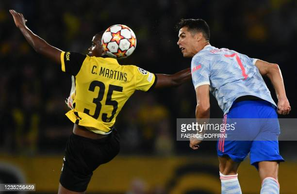 Manchester United's Portuguese striker Cristiano Ronaldo fights for the ball with Young Boys' Luxembourgish midfielder Christopher Martins during the...