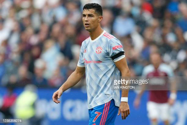 Manchester United's Portuguese striker Cristiano Ronaldo is seen wearing a black armband to honour Jimmy Greaves, former West Ham, Tottenham and...