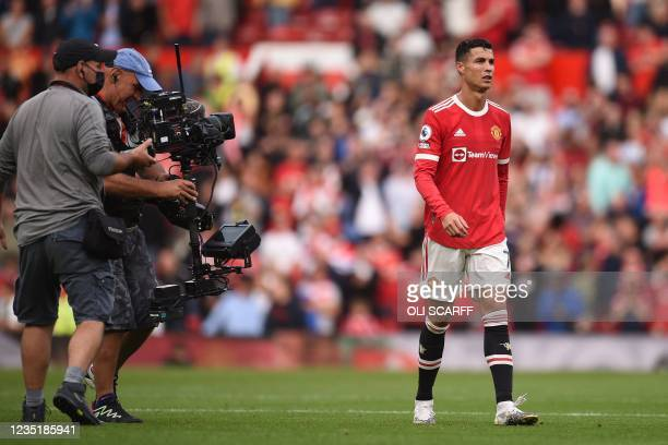 Manchester United's Portuguese striker Cristiano Ronaldo leaves after the English Premier League football match between Manchester United and...