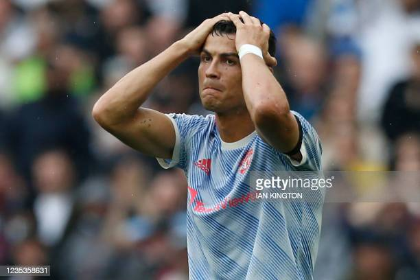 Manchester United's Portuguese striker Cristiano Ronaldo reacts after a decision goes against him during the English Premier League football match...