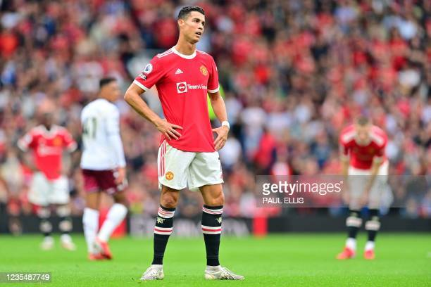 Manchester United's Portuguese striker Cristiano Ronaldo reacts during the English Premier League football match between Manchester United and Aston...