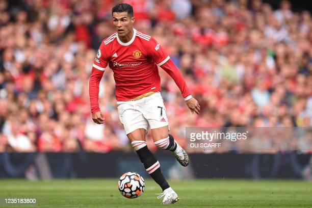 Manchester United's Portuguese striker Cristiano Ronaldo runs with the ball during the English Premier League football match between Manchester...