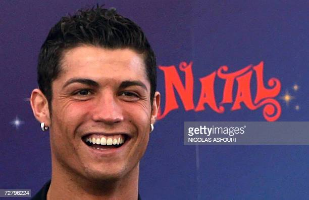 Manchester United's Portuguese striker Cristiano Ronaldo smiles as he gives Christmas presents to children in Obidos 70 km north of Lisbon 11...