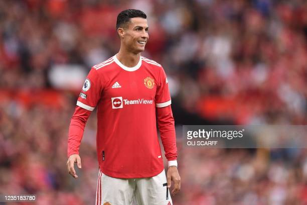 Manchester United's Portuguese striker Cristiano Ronaldo smiles during the English Premier League football match between Manchester United and...