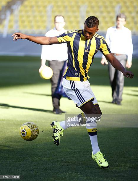 Manchester United's Portuguese winger Luis Nani joins Fenerbahce at the Istanbul clubs Sukru Saracoglu stadium in Istanbul after signing a threeyear...