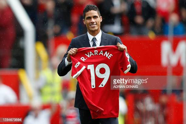 Manchester United's Raphael Varane is presented to the fans ahead of the English Premier League football match between Manchester United and Leeds...