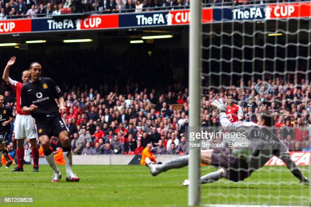 Manchester United's Rio Ferdinand scores past Arsenal's goalkeeper Jens Lehmann only for it to be disallowed