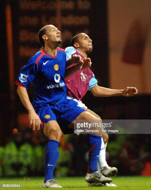 Manchester United's Rio Ferdinand tussles with West Ham United's Anton Ferdinand during the Barclays Premiership match at Upton Park London Sunday...