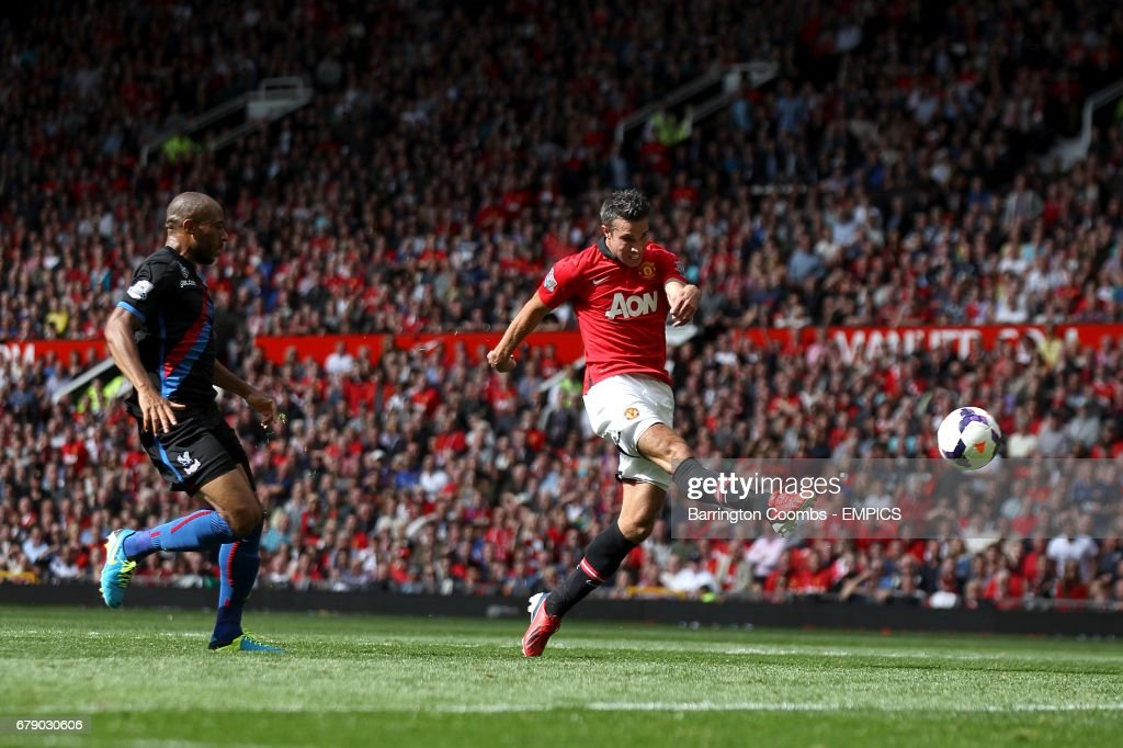 Manchester United's Robin van Persie has a shot on target