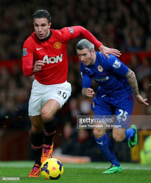 Manchester United's Robin van Persie sprints away from Cardiff City's Kevin McNaughton during the Barclays Premier League match at Old Trafford...