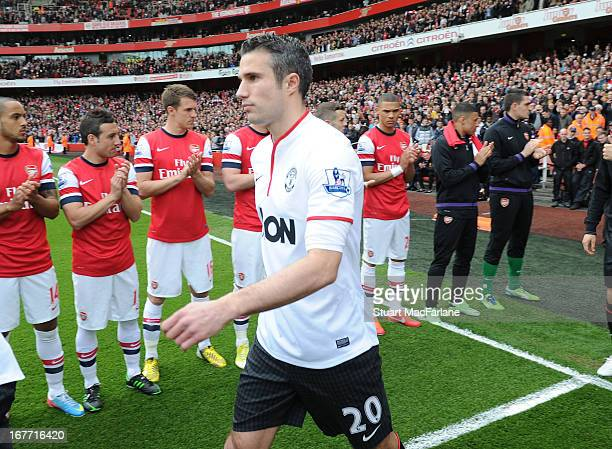 Manchester United's Robin van Persie walks through Arsenal's Guard Of Honour before the Barclays Premier League match between Arsenal and Manchester...