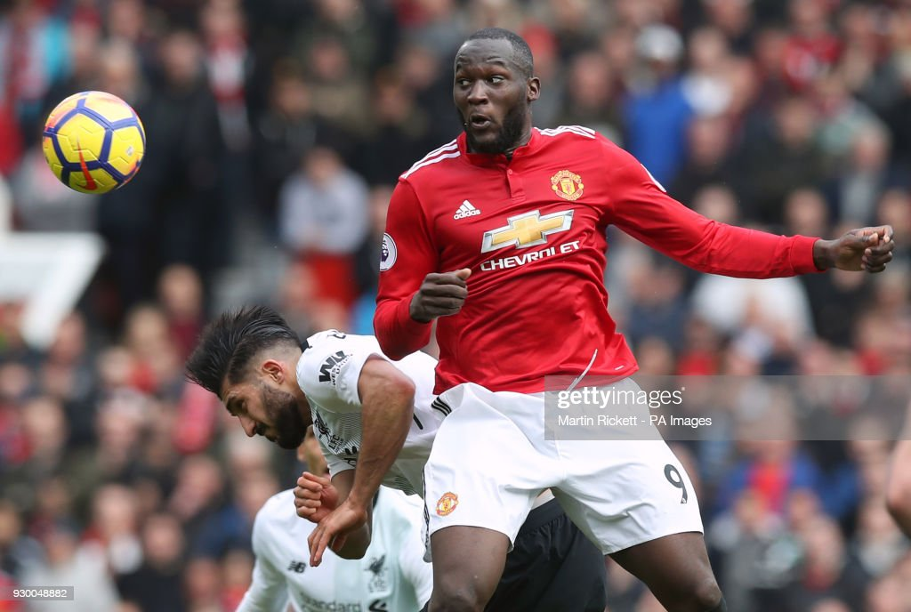 Manchester United's Romelu Lukaku (right) and Liverpool's Emre Can battle for the ball during the Premier League match at Old Trafford, Manchester.