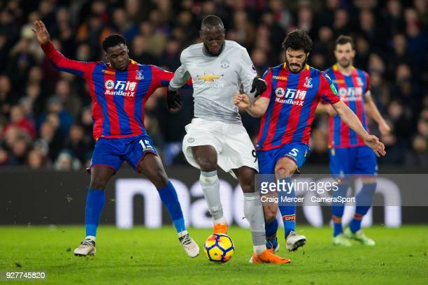 Manchester United's Romelu Lukaku battles for possession with Crystal Palace's James Tomkins and Crystal Palace's Jeffrey Schlupp during the Premier...
