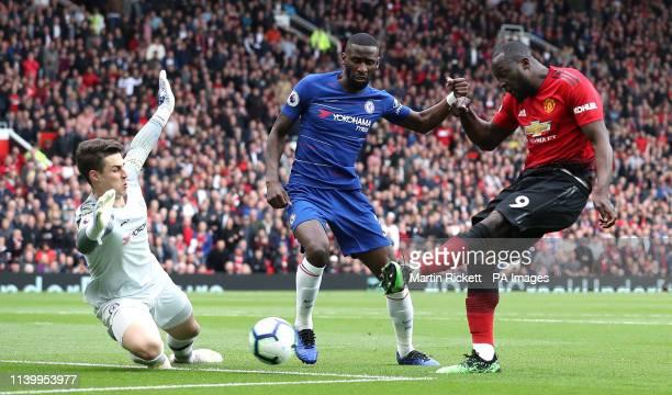 Manchester United's Romelu Lukaku has a shot blocked by Chelsea goalkeeper Kepa Arrizabalaga and Antonio Rudiger during the Premier League match at...