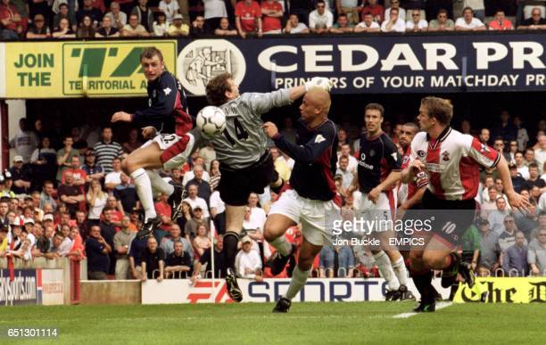 Manchester United's Ronnie Wallwork Andy Goram and Wes Brown fail to clear the ball as Southampton's Kevin Davies looks to profit
