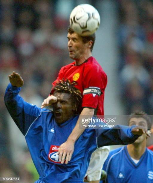 Manchester United's Roy Keane climbs above Aliou Cisse of Birmingham City during their FA Barclaycard Premiership match at Manchester Utd's Old...