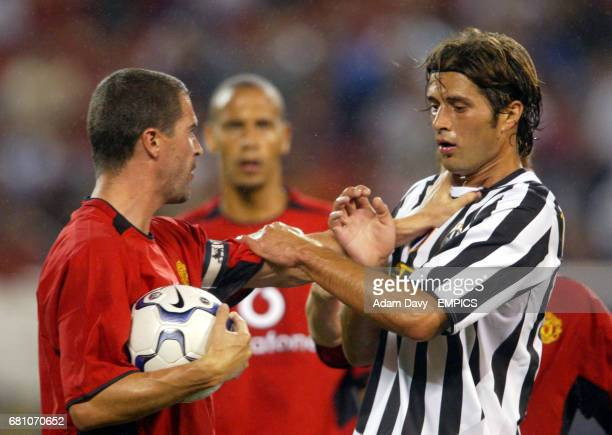 Manchester United's Roy Keane gets to grips with Juventus' Alessio Tacchinardi