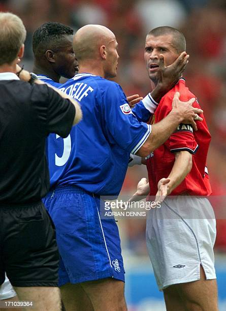 Manchester United's Roy Keane is calmed down by Chelsea's Franck Leboeuf as the referee calls Keane over after he scuffled with Chelsea's Roberto Di...