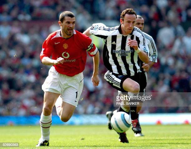 Manchester United's Roy Keane runs for the ball with Newcastle's Andy O'Brien during their Premiereship match at Old Trafford in Manchester 24 April...