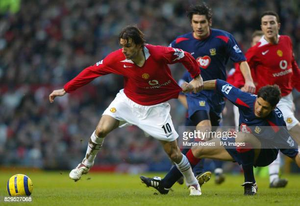 Manchester United's Ruud Van Nistelrooy battles with Portsmouth's Dejan Stefanovic