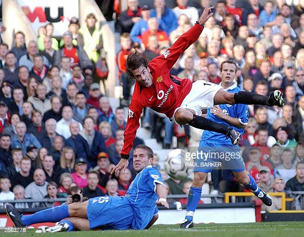Manchester United's Ruud van Nistelrooy goes flying after a tackle from Birmingham City's Matthew Upson during today's Barclaycard Premiership clash...