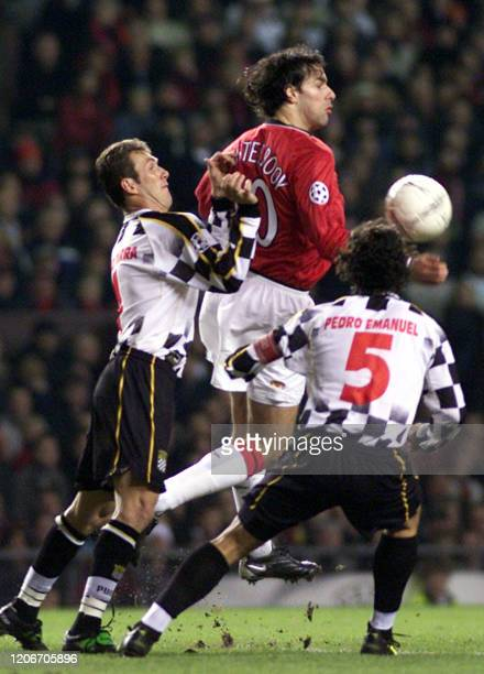 Manchester United's Ruud van Nistelrooy is challenged by Boavista's Pedro Emanuel and Paulo Turra during the Champions League Phase Two Group A match...