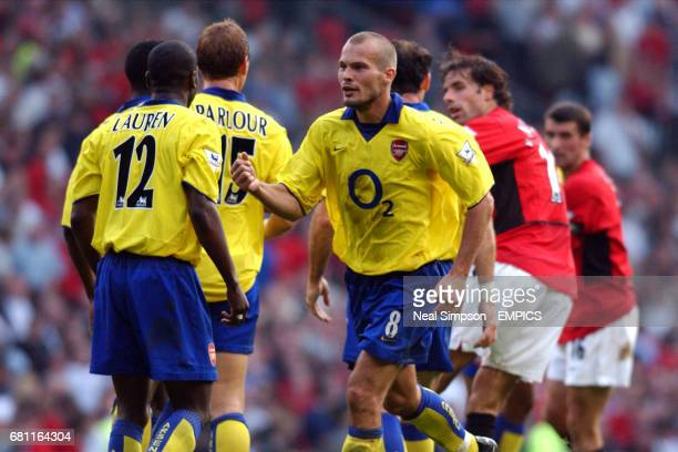 Manchester United's Ruud van Nistelrooy is surrounded at the final whistle by Arsenal's Lauren Ray Parlour and Martin Keown as Fredrik Ljungberg...