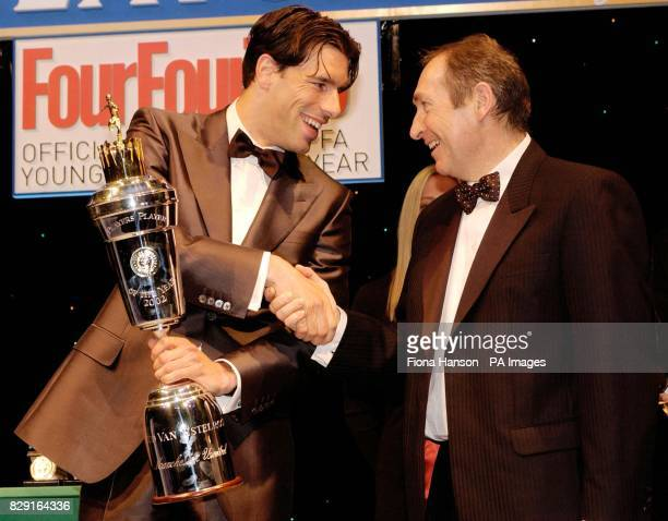 Manchester United's Ruud van Nistelrooy with the PFA Player of the Year trophy from Liverpool Manager Gerard Houllier during the PFA's annual dinner...