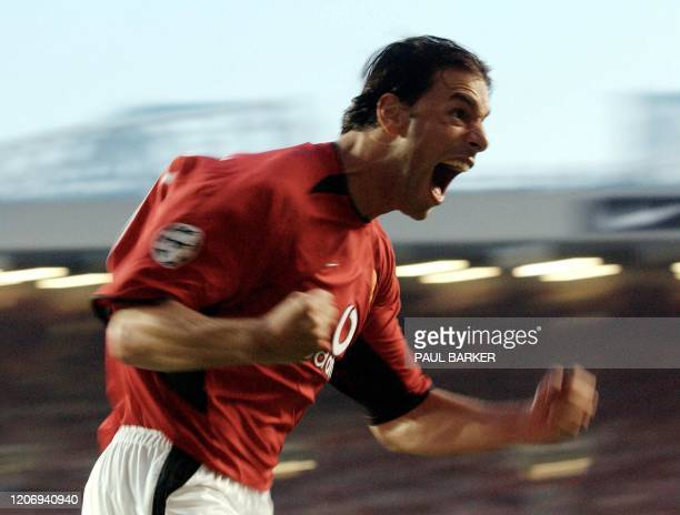 Manchester United's ruud van Nistgelrooy goes wild 27 August 2002 after putting his team 1 up against Zalaegerszegi TE in their UEFA Champions league...