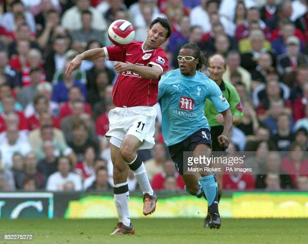 Manchester United's Ryan Giggs and Tottenham's Edgar David's during the Barclays Premiership match at Old Trafford Manchester