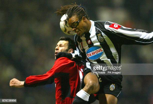 Manchester United's Ryan Giggs challenges Edgar Davids of Juventus for the ball during the UEFA Champions League group D match at Old Trafford...