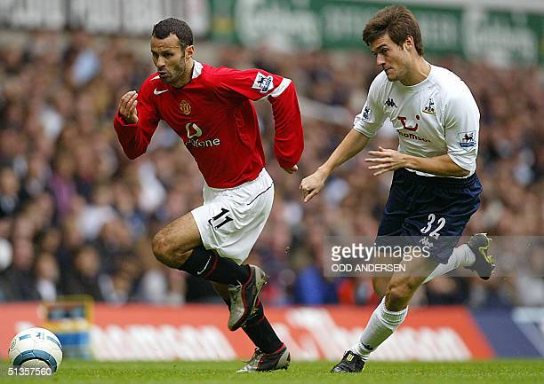 Manchester United's Ryan Giggs is chased by Johnnie Jackson of Tottenham during their Premier League clash at White Hart Lane in north London 25...