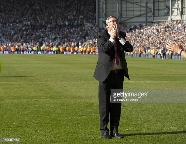 Manchester United's Scottish manager Alex Ferguson acknowledges fans at the end of the English Premier League football match between West Bromwich...