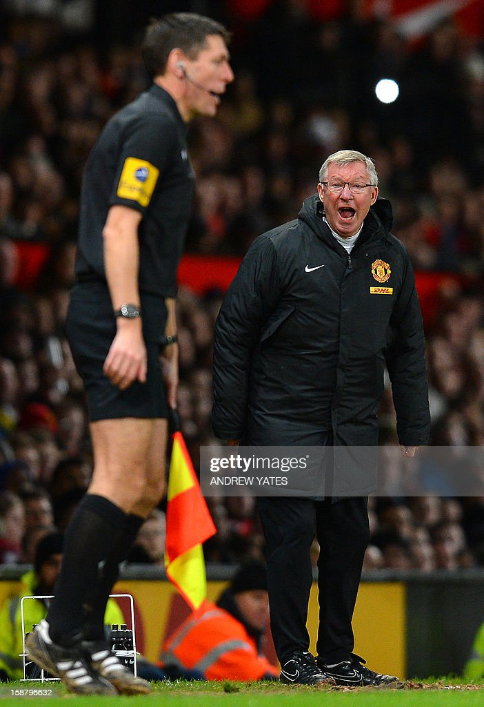 """Manchester United's Scottish manager Alex Ferguson (R) shouts at assistant referee Andy Garrett during the English Premier League football match between Manchester United and West Bromwich Albion at Old Trafford in Manchester, north-west England on December 29, 2012. Manchester United won the game 2-0. USE. No use with unauthorized audio, video, data, fixture lists, club/league logos or """"live"""" services. Online in-match use limited to 45 images, no video emulation. No use in betting, games or single club/league/player publications"""