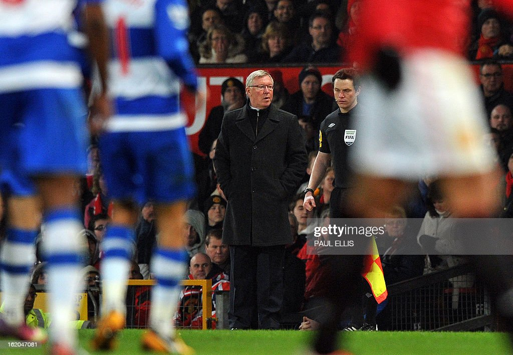 """Manchester United's Scottish manager Alex Ferguson watches the action during the English FA Cup fifth round football match between Manchester United and Reading at Old Trafford in Manchester, north west England, on February 18, 2013. USE. No use with unauthorized audio, video, data, fixture lists, club/league logos or """"live"""" services. Online in-match use limited to 45 images, no video emulation. No use in betting, games or single club/league/player publications."""