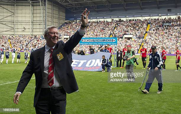 Manchester United's Scottish manager Alex Ferguson waves to fans before the start of the English Premier League football match between West Bromwich...