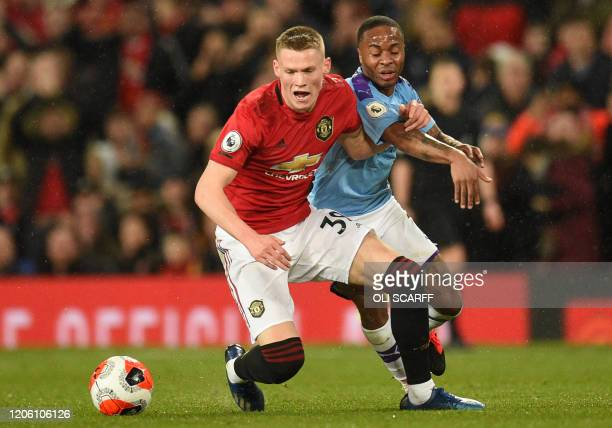 Manchester United's Scottish midfielder Scott McTominay vies for the ball with Manchester City's English midfielder Raheem Sterling during the...