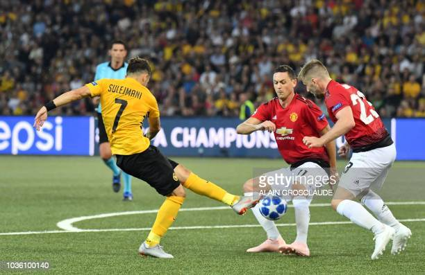 Manchester United's Serbian midfielder Nemanja Matic and Manchester United's English defender Luke Shaw defend against Young Boys Serbian midfielder...